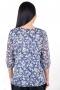 Елегантна блуза от релефен плат с шифон, подходяща за официални поводи.